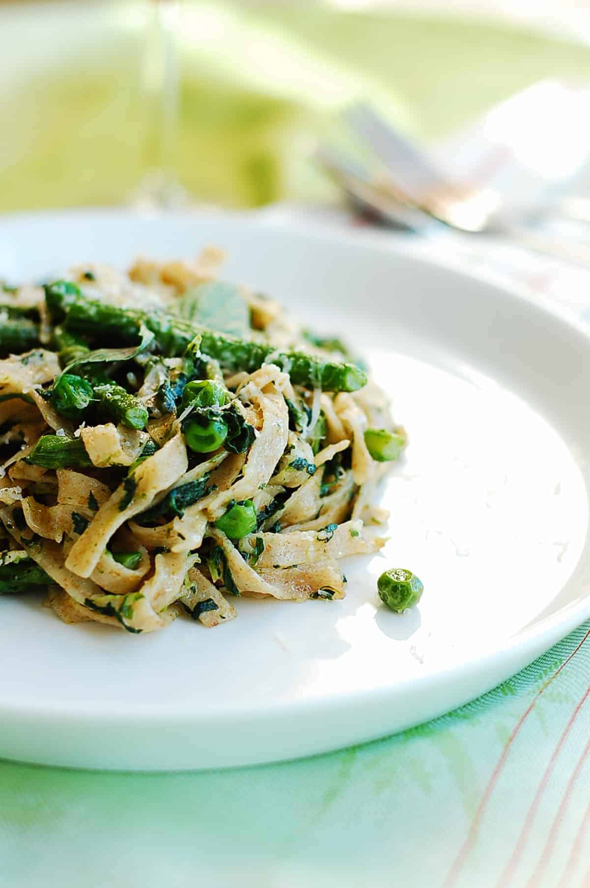 a serve of pasta tossed with greens