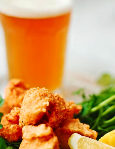 prawn cakes served with beer