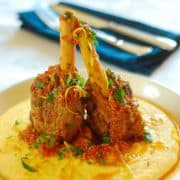 slow cooked lamb shanks served with polenta on a plate