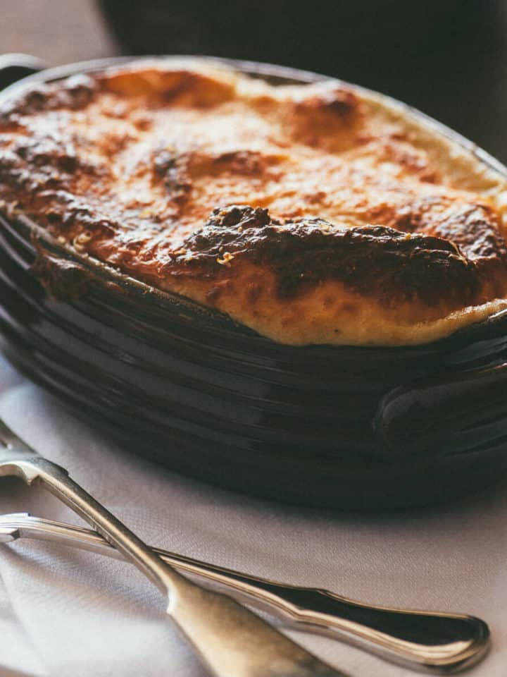 a vegetarian pie served in a ceramic oval baking dish