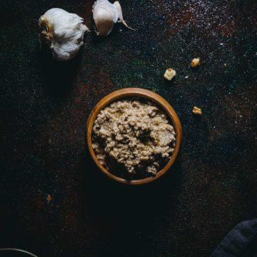 Greek walnut skordalia served in a wooden bowl