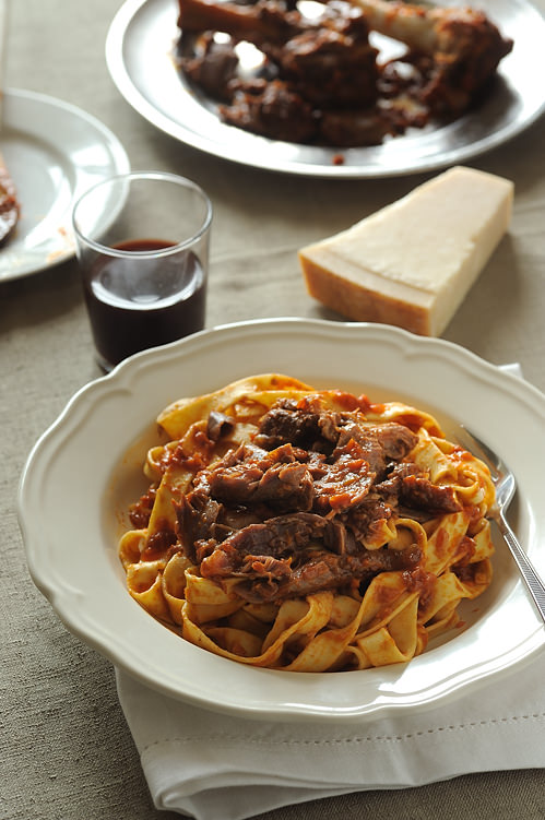 braised lamb shanks served with fettucine