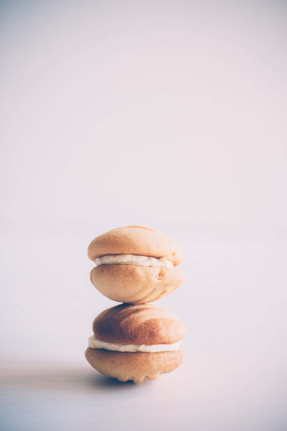 two small sandwich cookies stacked on top of each other
