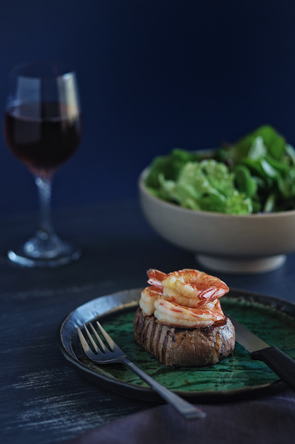 seared steak with cooked prawns