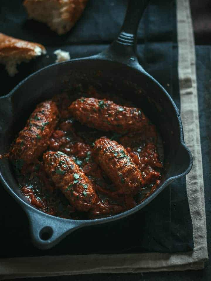 oblong Greek meatballs cooked in a pan