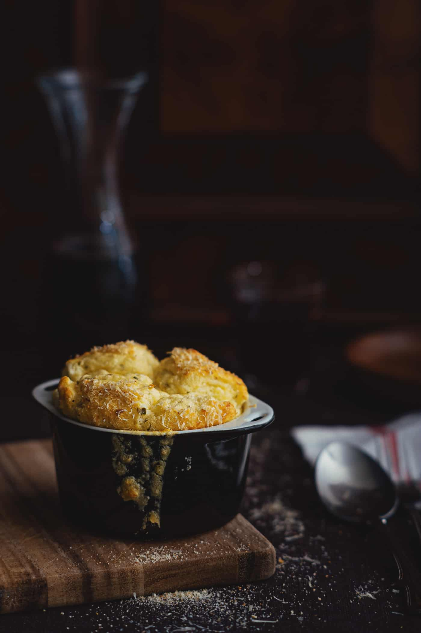 a cheese soufflé served in a ramekin
