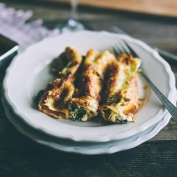 pasta tubes filled with ricotta and spinach served on a plate