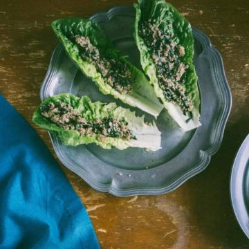 three Romaine lettuce leaves filled with an Asian mushroom mixture
