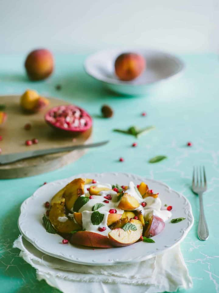 peach salad smothered in yoghurt served on a plate