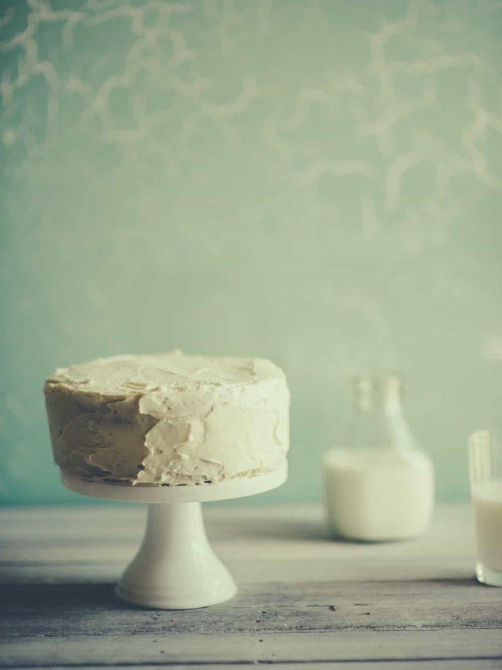 a vanilla sponge cake on a cake stand