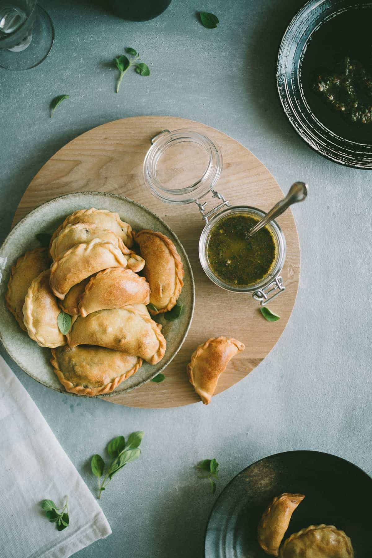 Lamb Empanadas with an oregano chimichurri dipping sauce