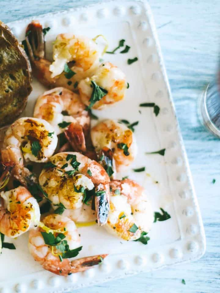 barbecued prawns served on a white plate