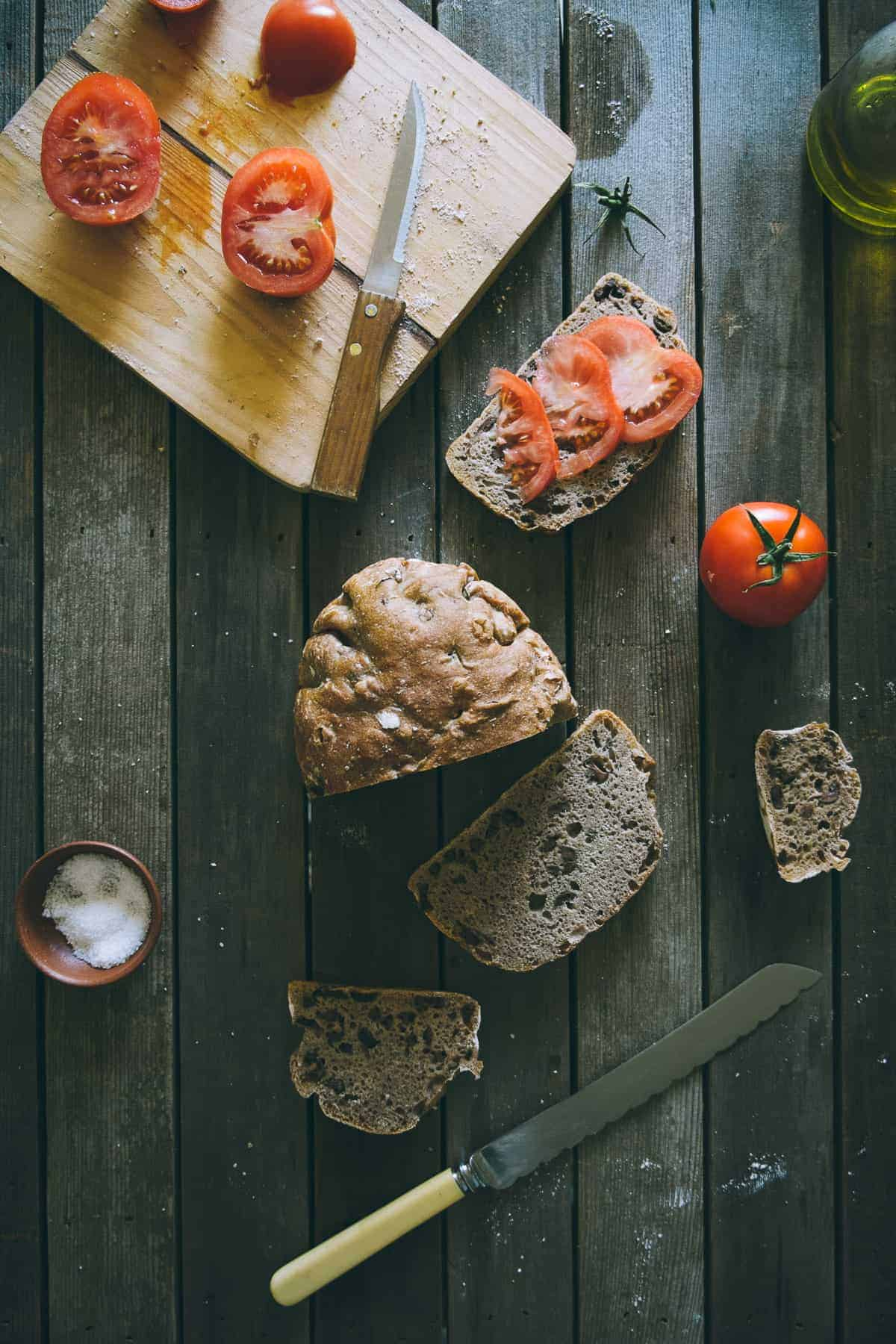 tomato slices on no knead olive bread