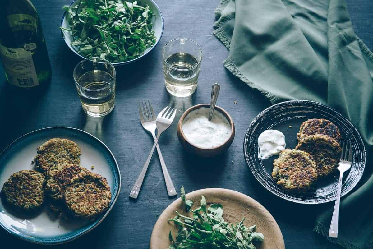 lentil cakes served with yoghurt and watercress