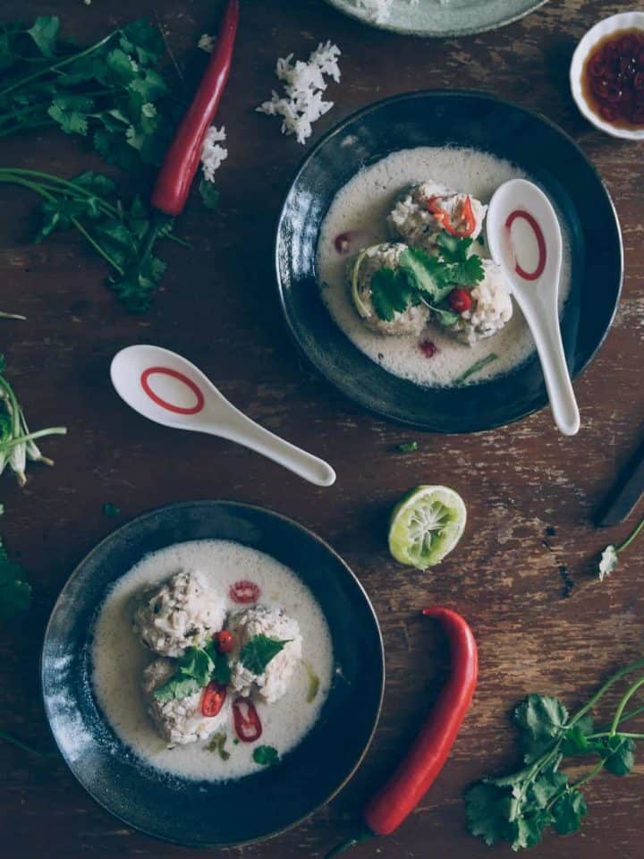 two bowls of chicken meatball soup served with Thai flavours