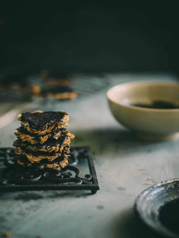 5 baklava Florentines stacked neatly on a grey table