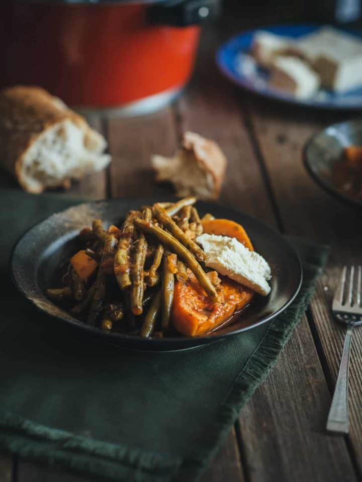 a plate filled with Greek style braised green beans