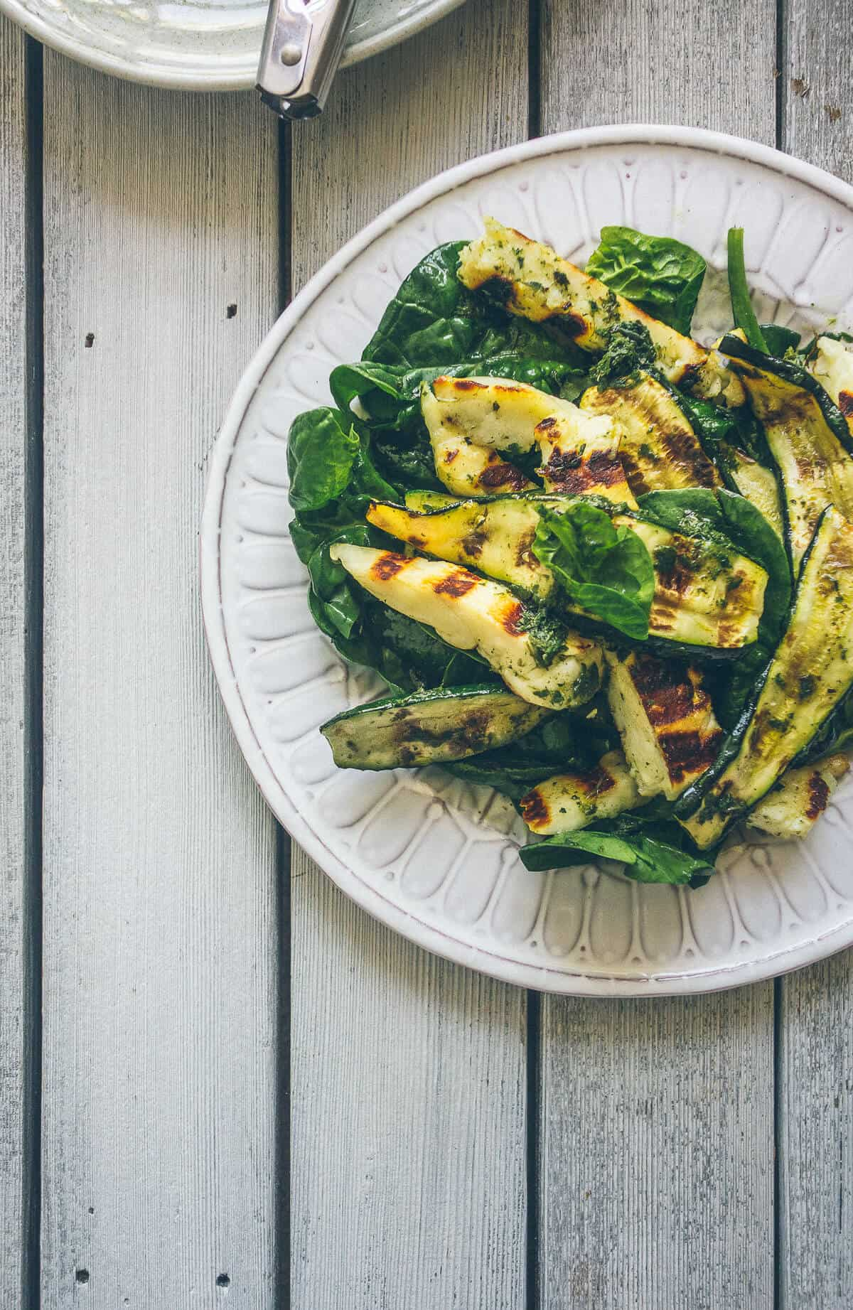 a white plate filled with zucchini and halloumi