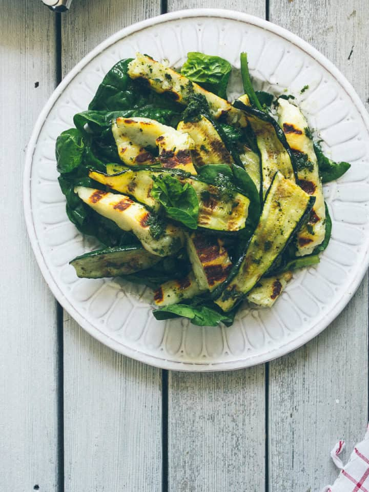 a plate filled with a salad made with zucchini and halloumi