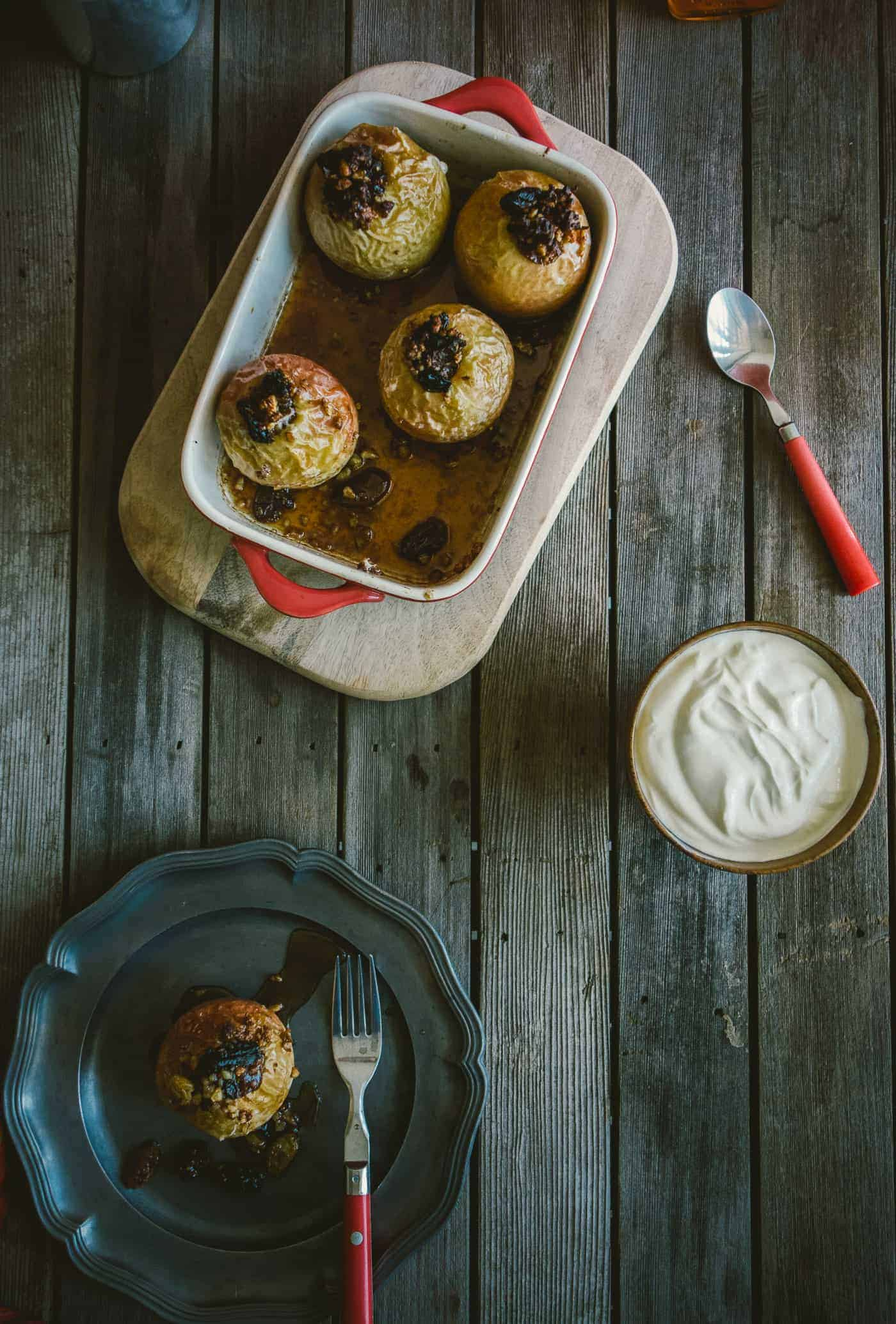 baked apples flavoured with rum and raisin on a rustic table