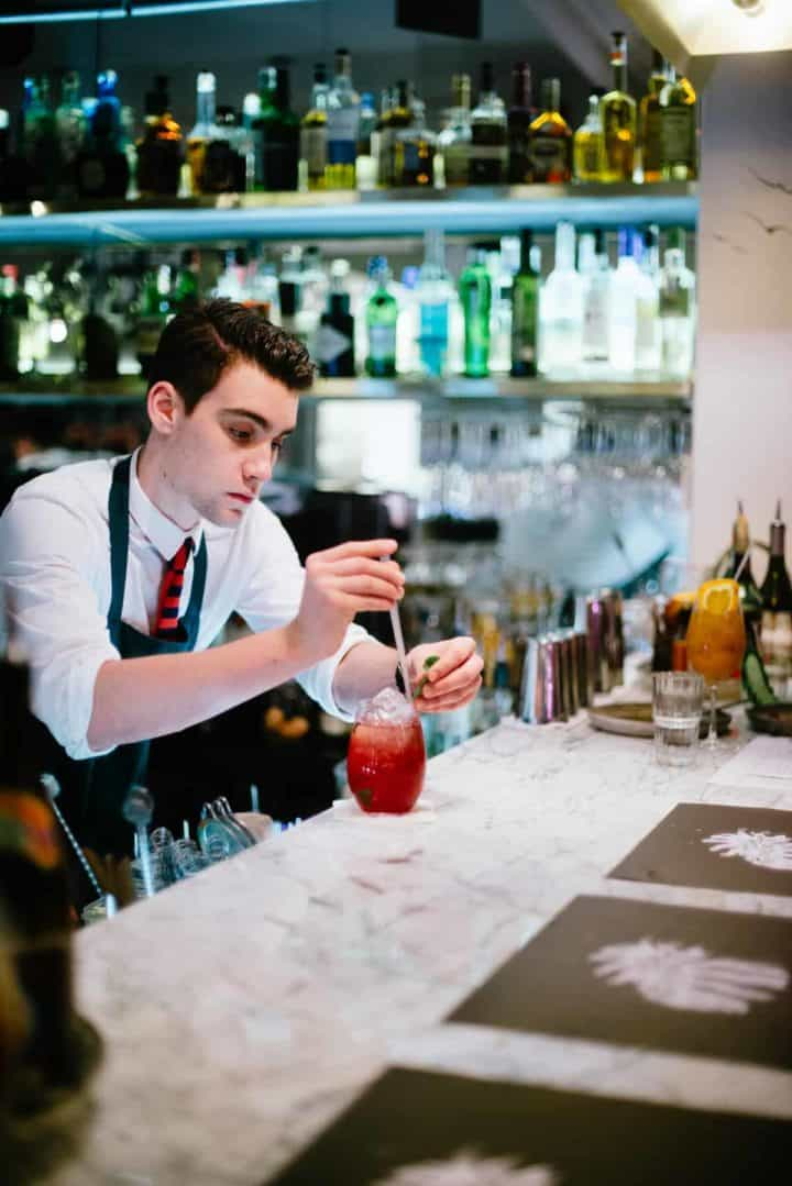 barman making cocktails in restaurant