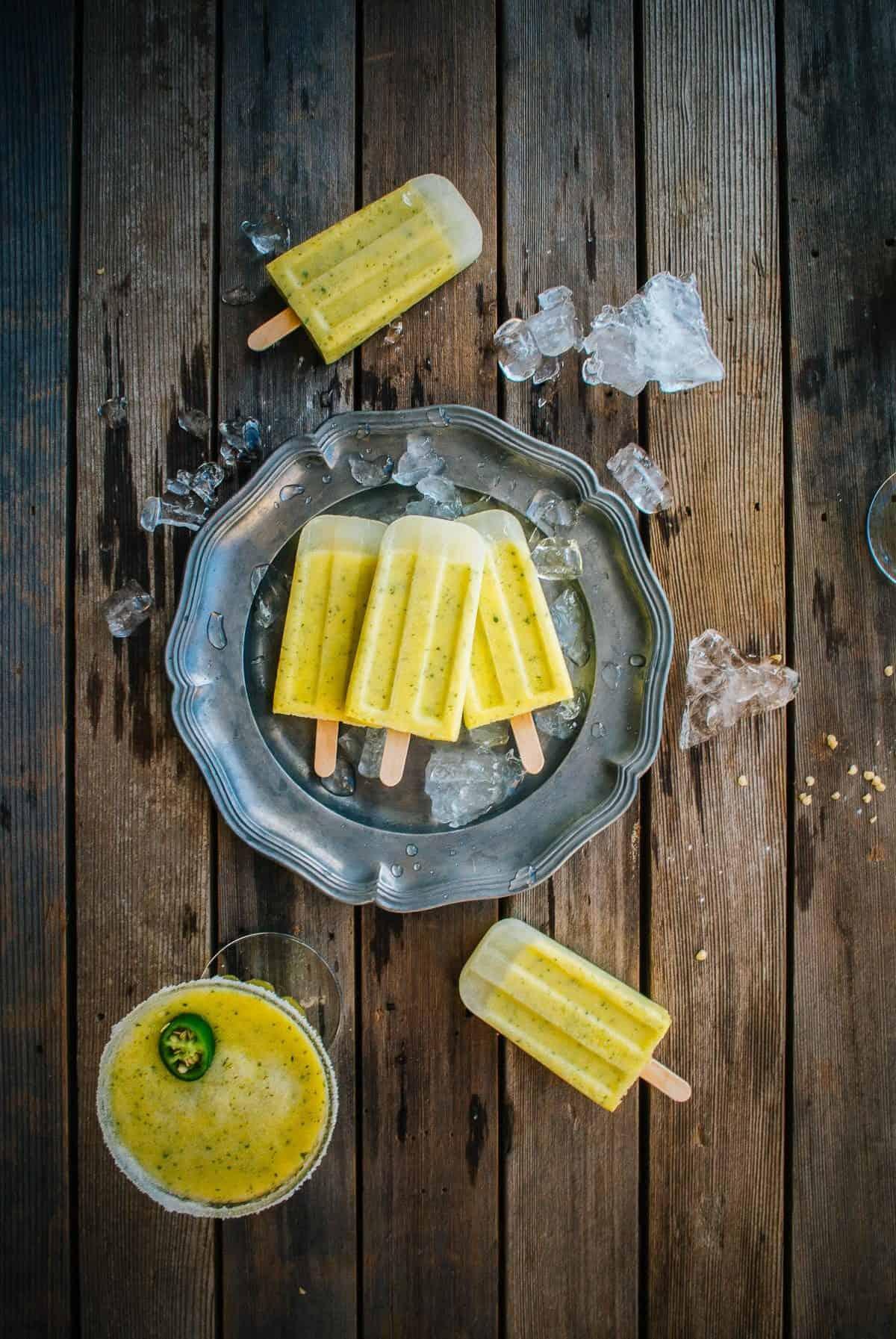 homemade pineapple margarita ice pops on a plate