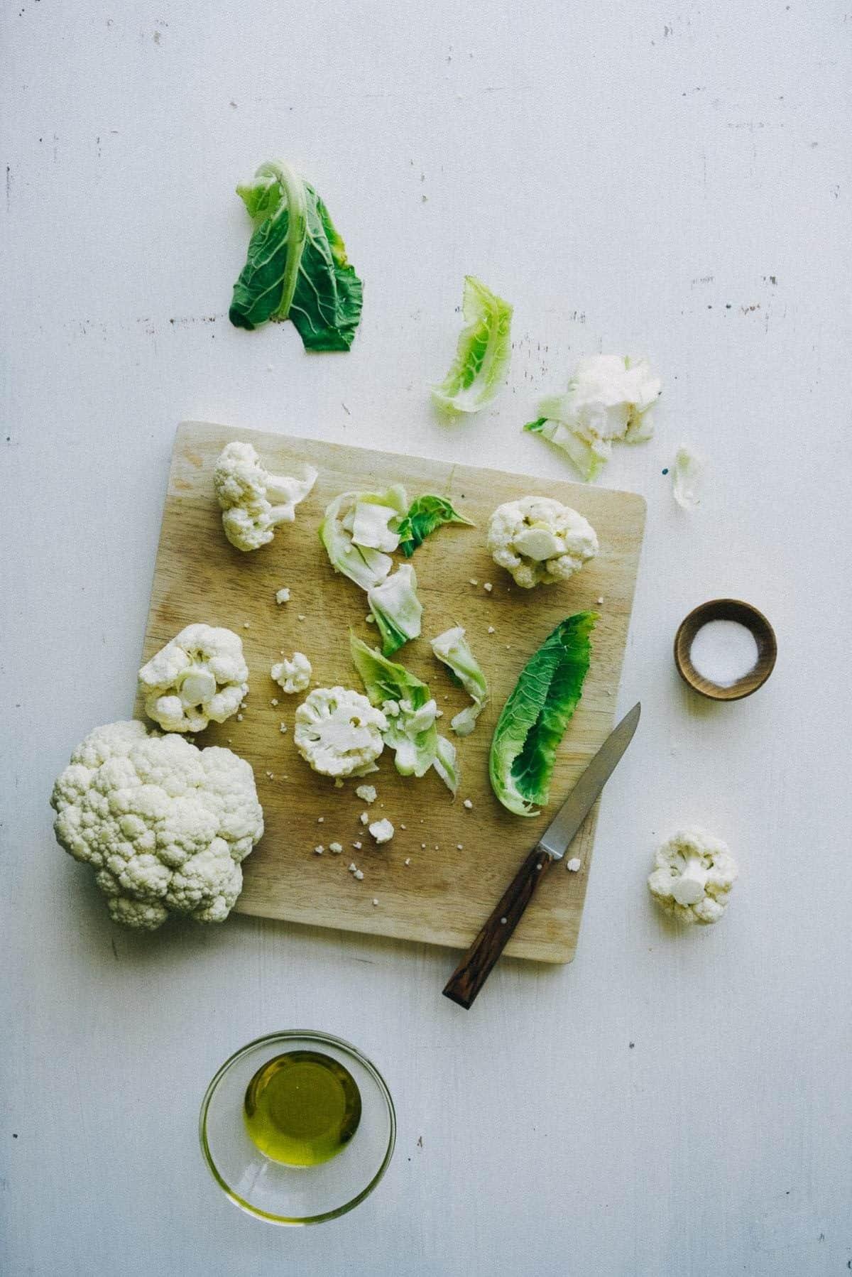 cauliflower florets on a chopping board