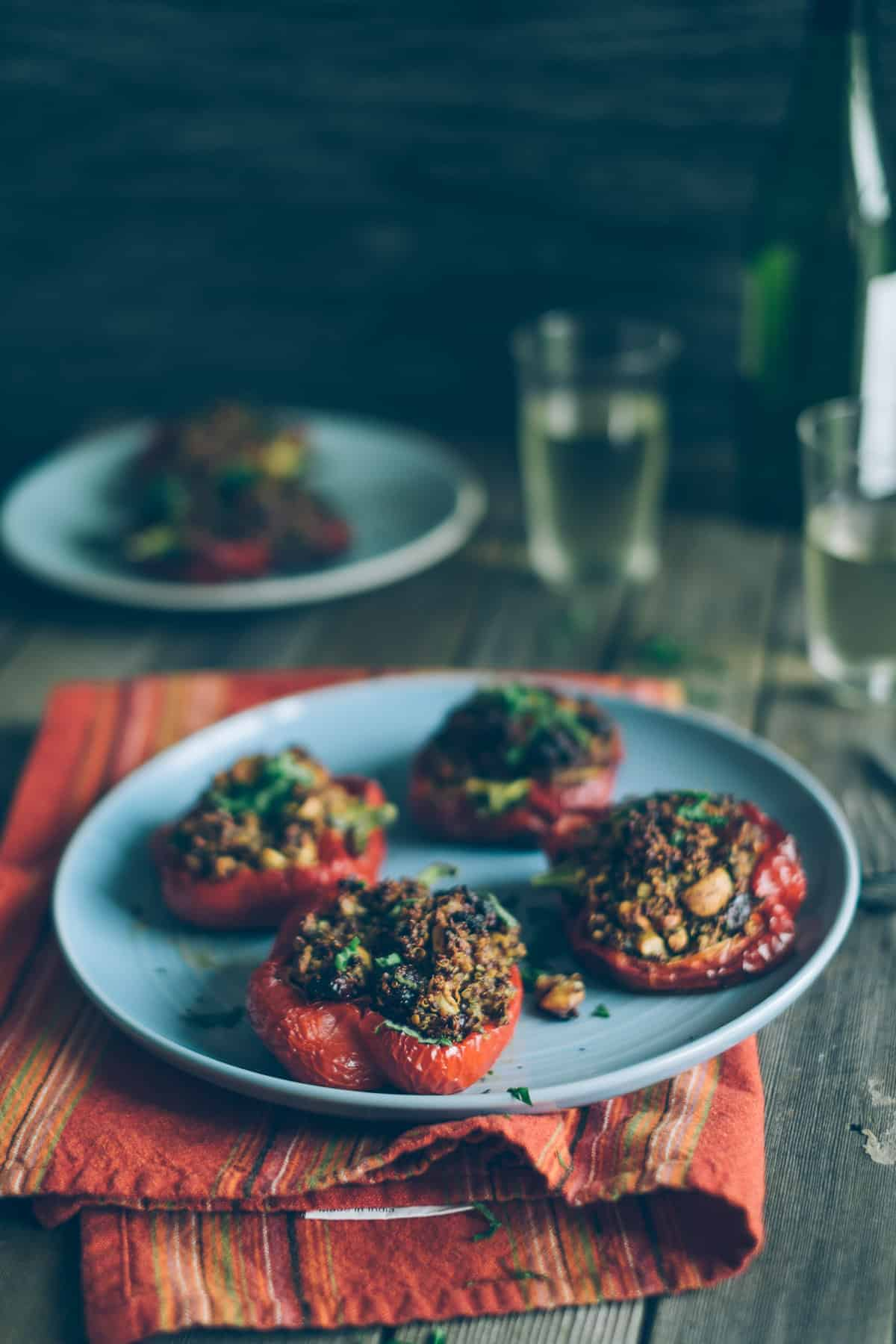 red peppers filled with quinoa on a plate