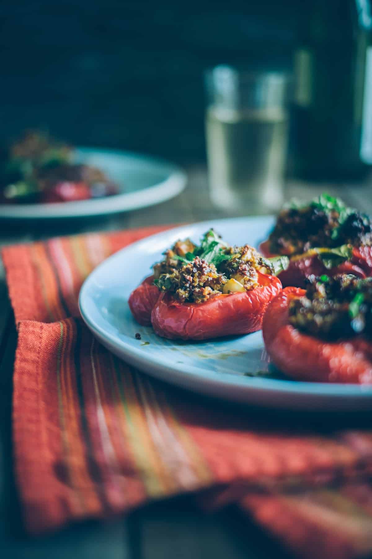 red peppers stuffed with quinoa on a plate
