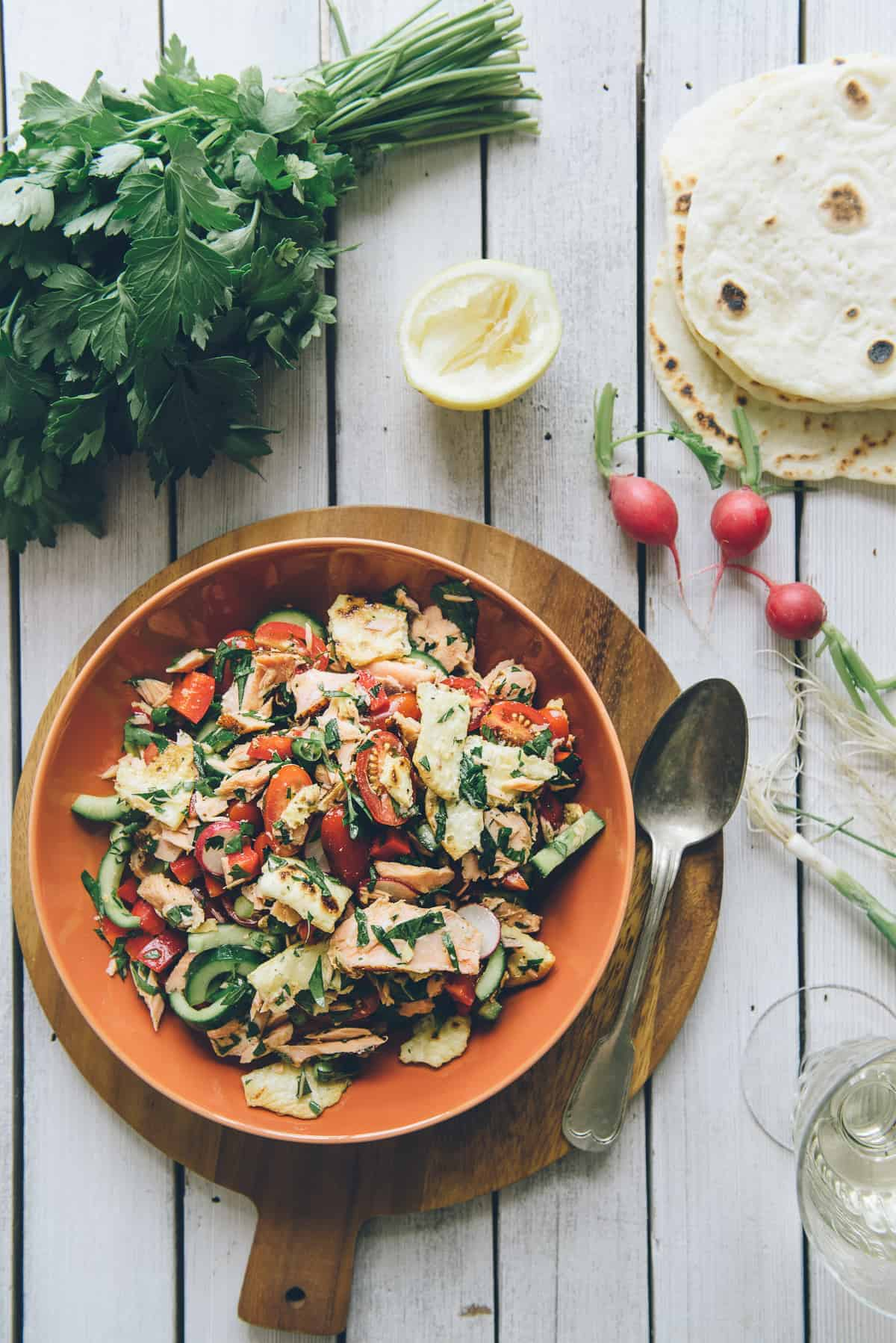 fattoush salad recipe with hot smoked salmon served on a plate