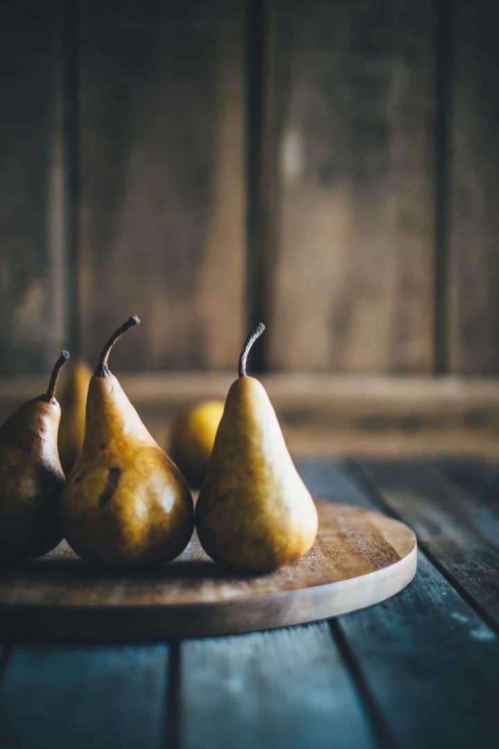 Beurre Bosc pears on a board