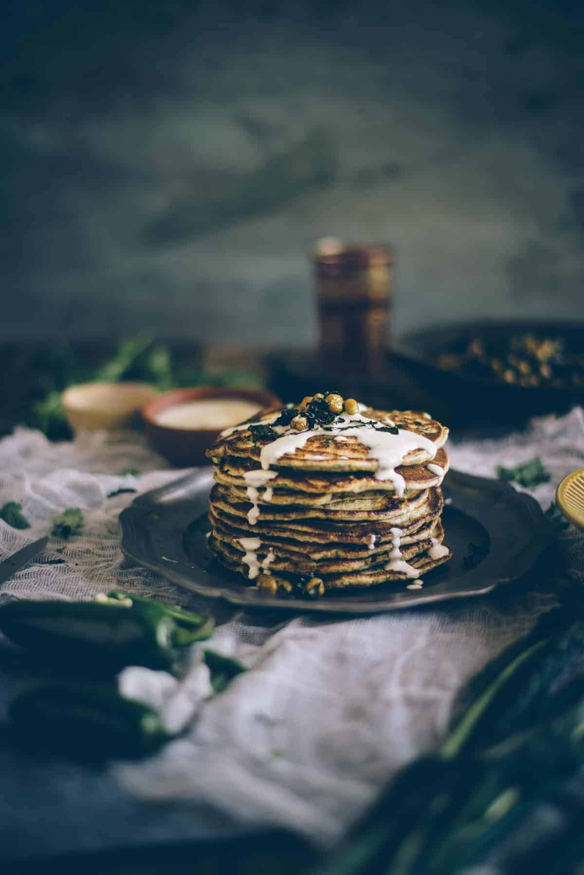 a stack of Middle Eastern pancakes drizzled with tahini