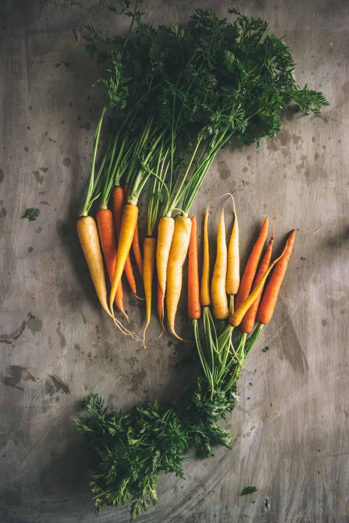 heirloom baby carrots on a table
