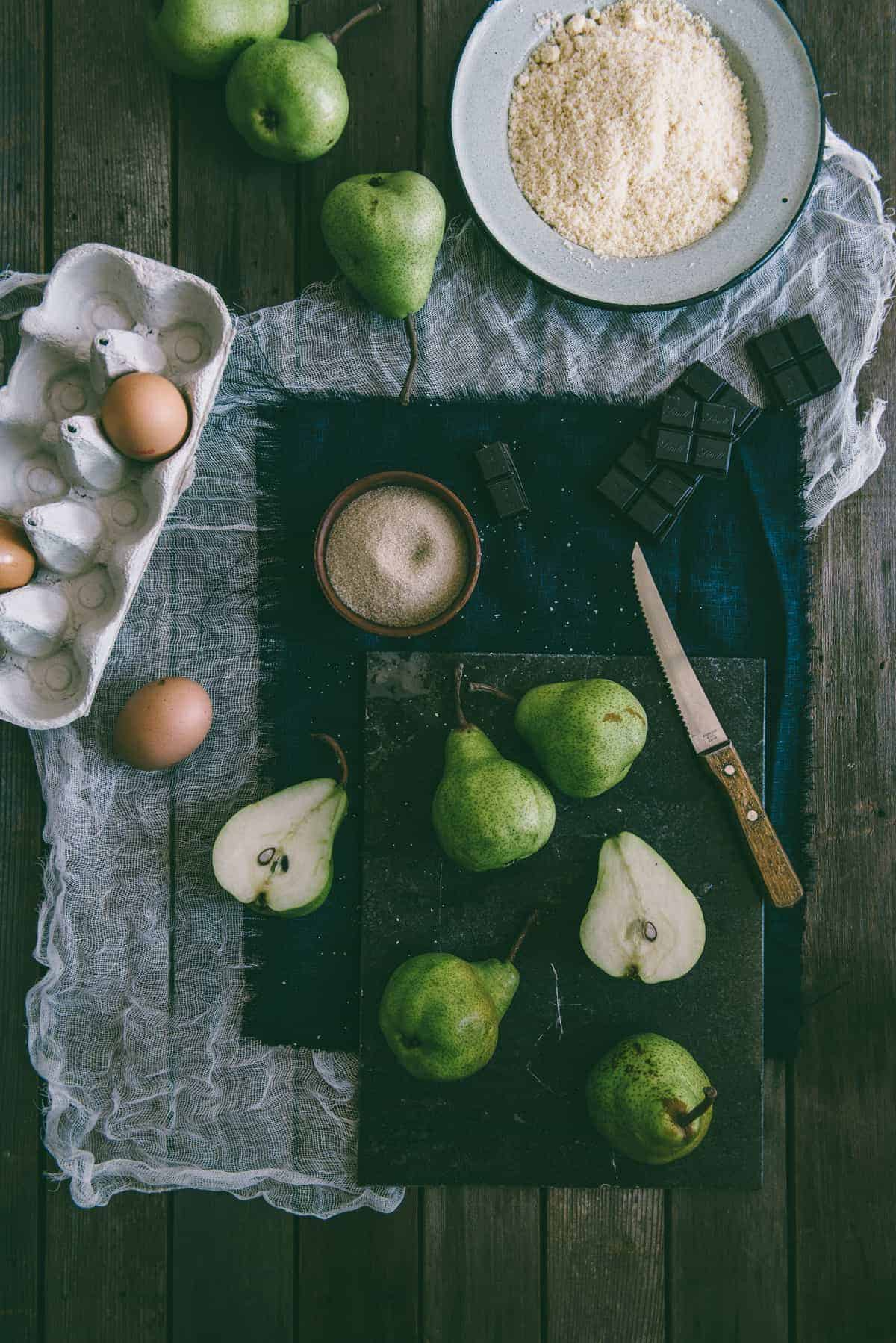 pears on a table with eggs and almond flour