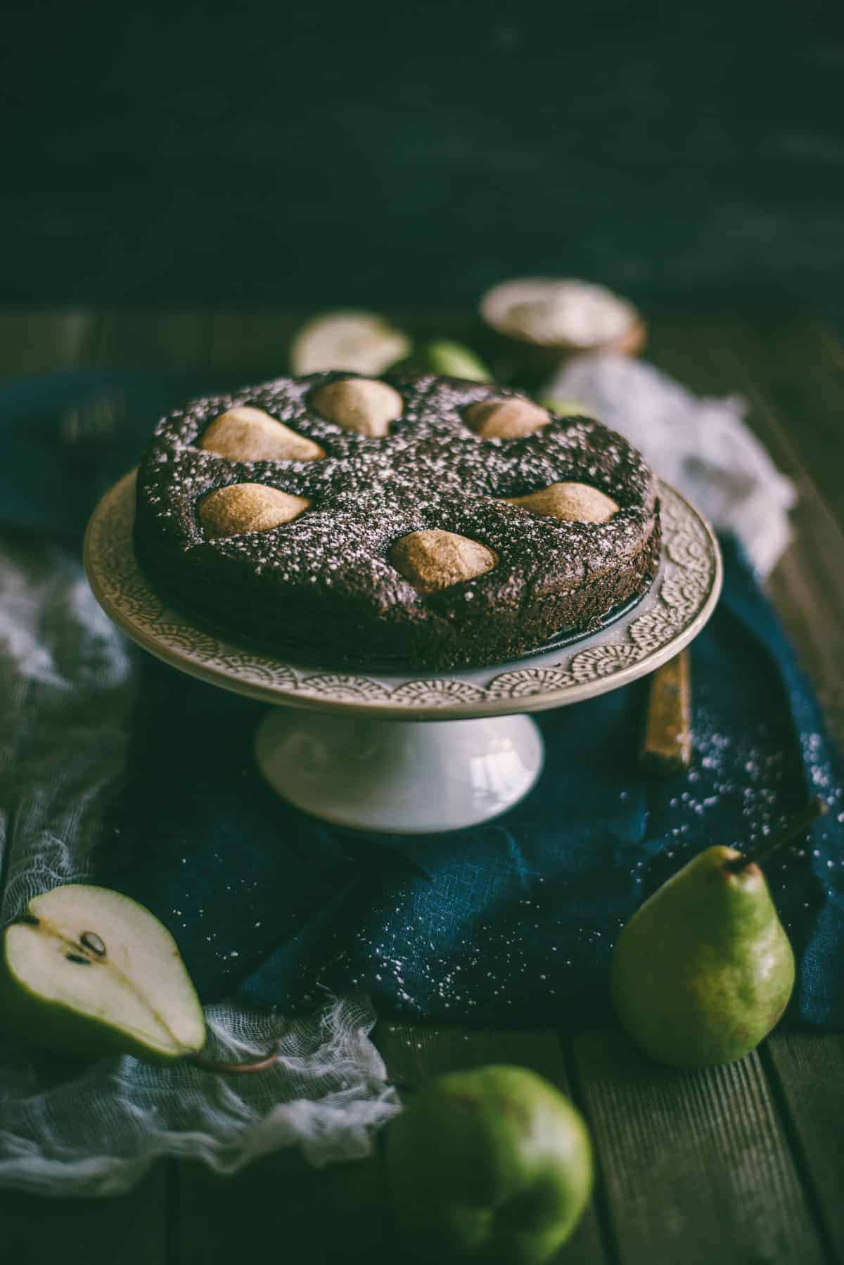 chocolate and pear cake on a stand
