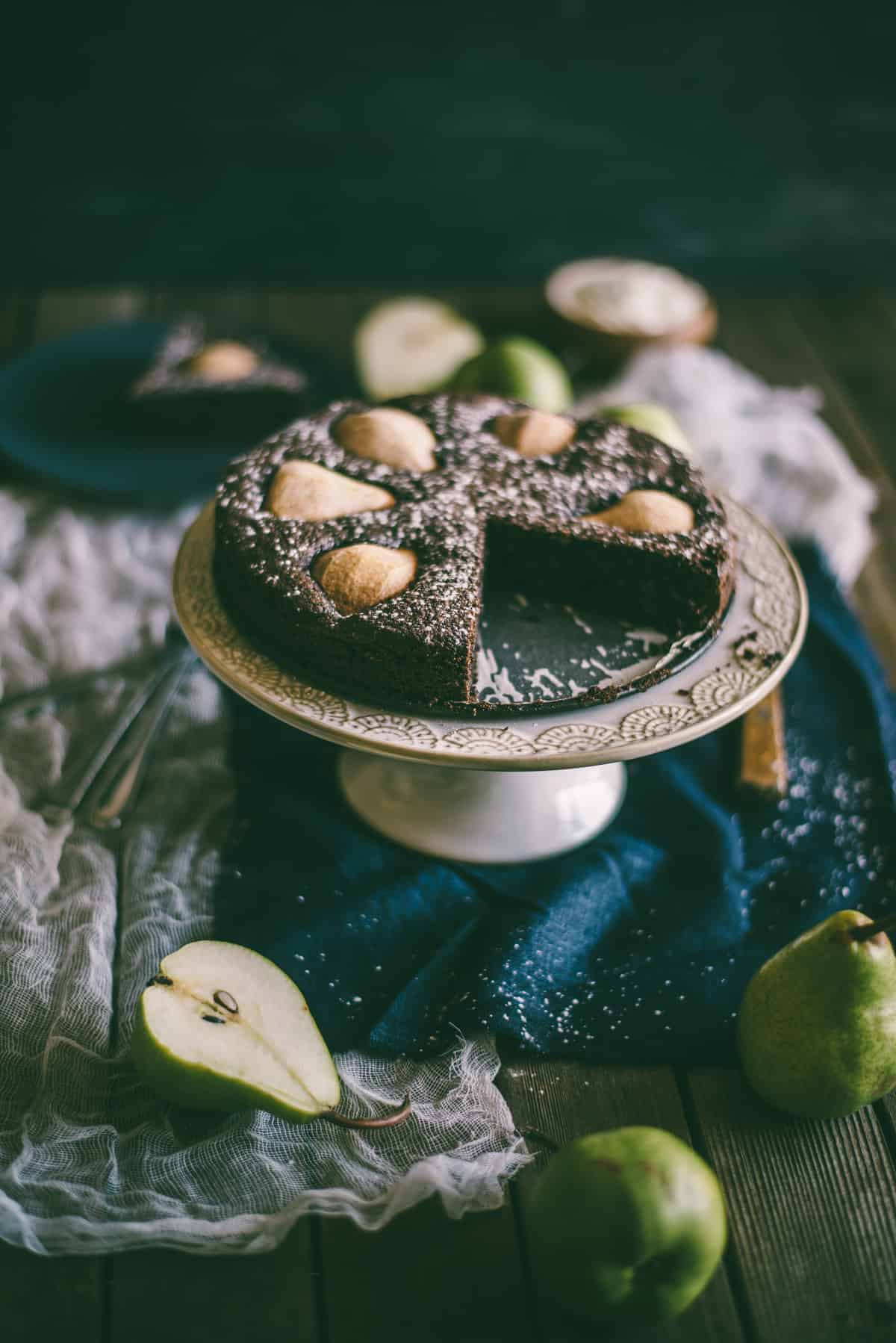 a chocolate cake with pears