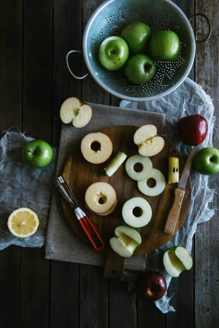 cut, raw apple rings being prepared to be made into fritters