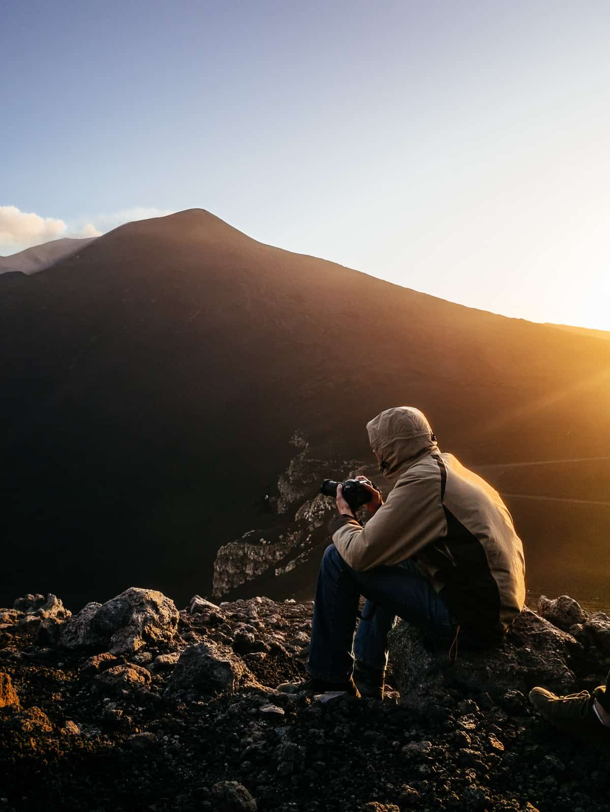 photographer capturing sunset pictures of Mount Etna