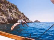 diving into Mazzaro Beach from a boat