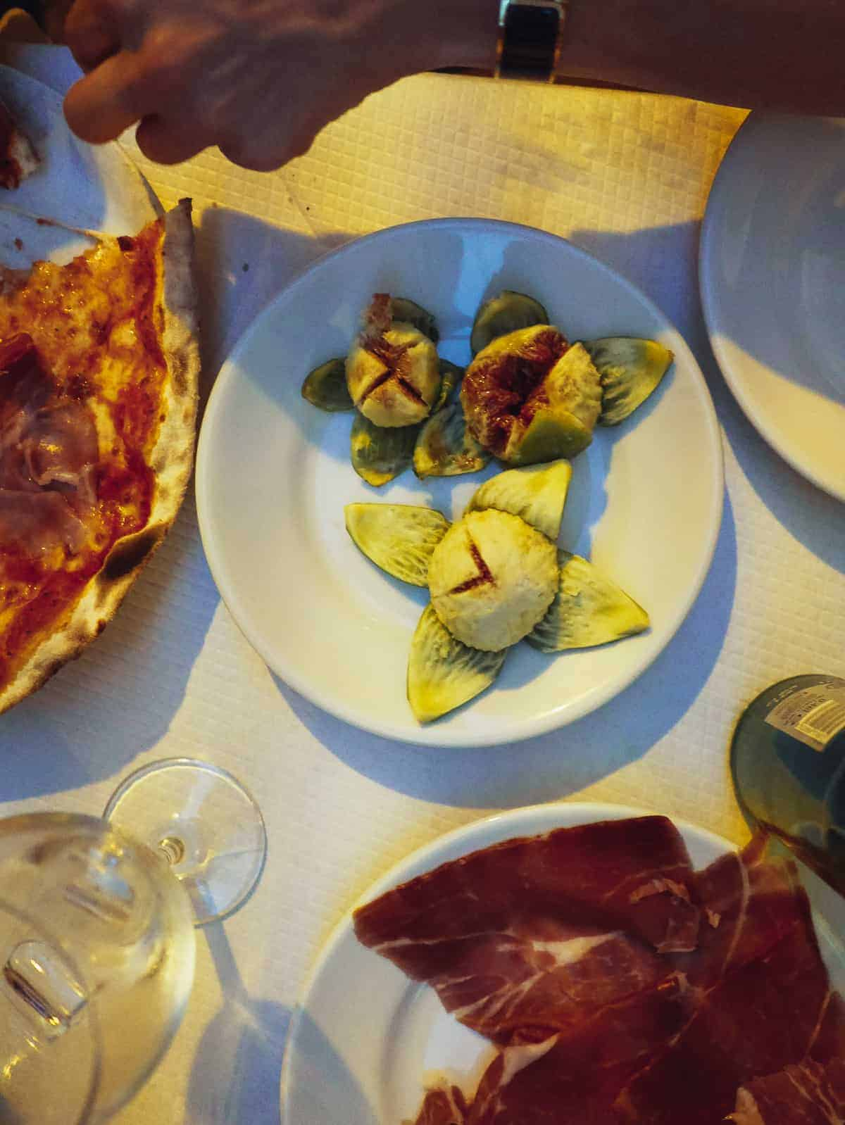 fresh figs and prosciutto served in a restaurant