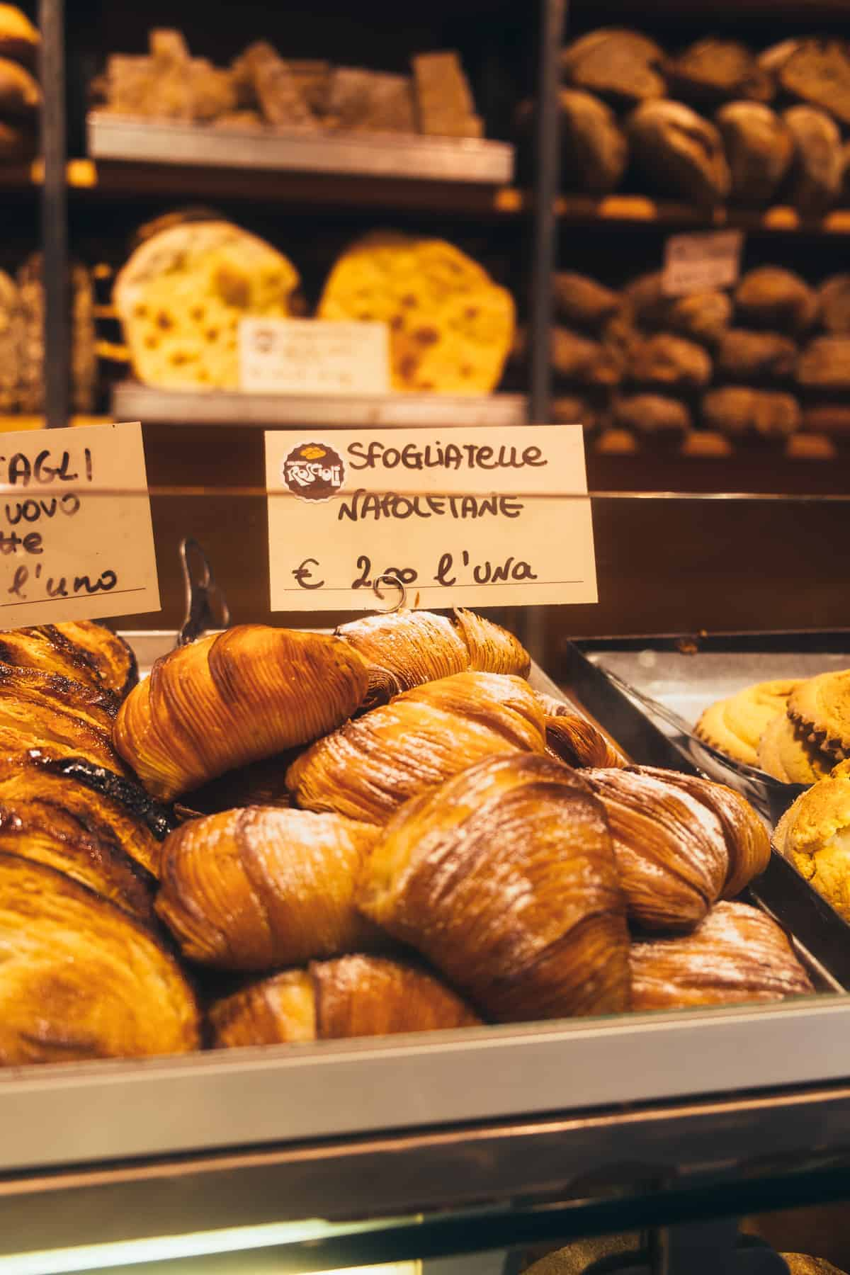 selection of sfogliatelle (shell-shaped flaky pastry dessert) sold in a shop