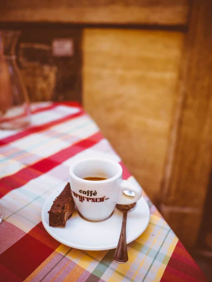 espresso coffee served in espresso cup on multicoloured tablecloth in Rome, Italy
