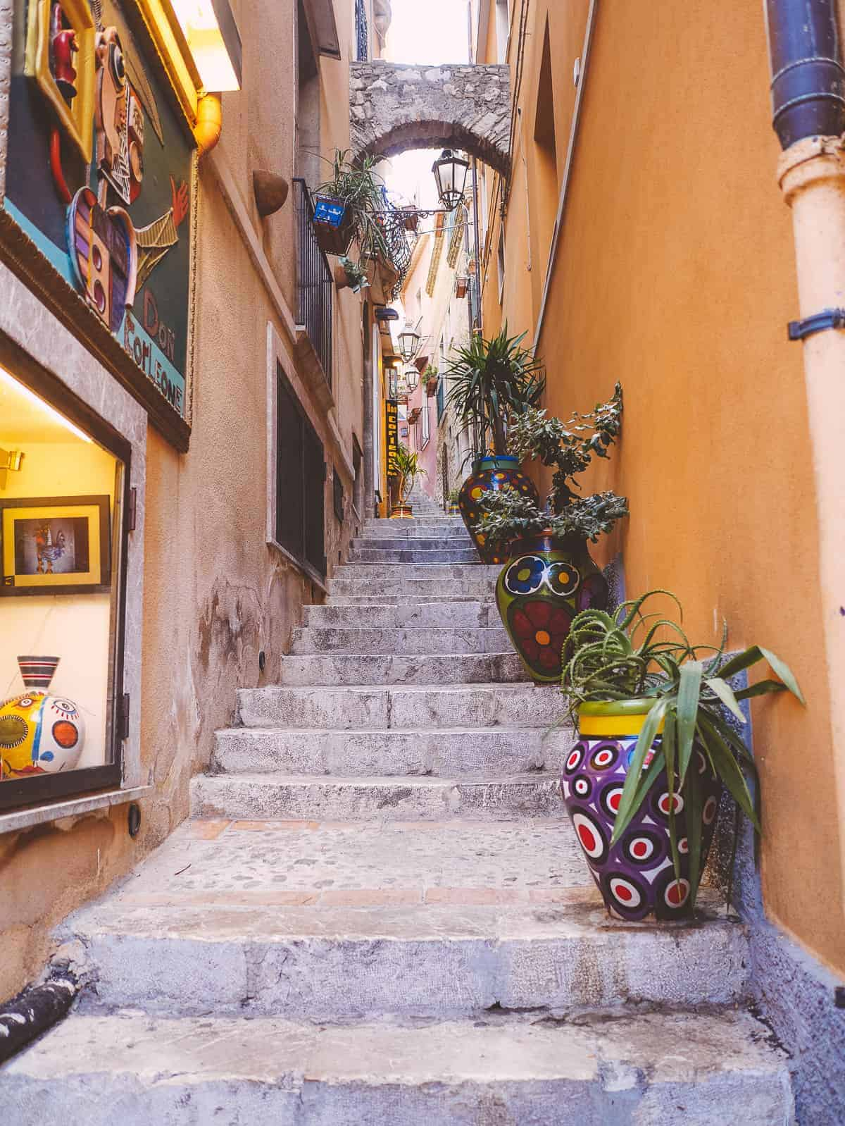 staircase with colourful pots in Italy