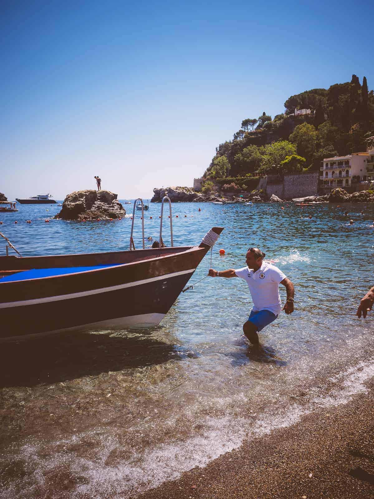 anchoring boat Mazzaro Beach Taormina Sicily