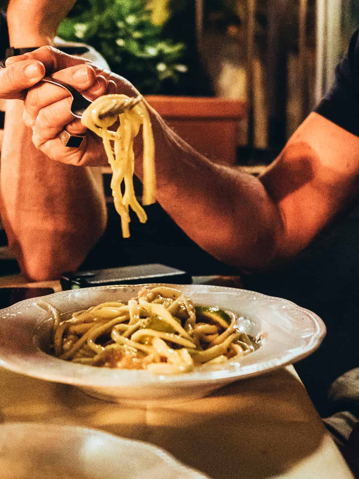 pasta on a fork in Italian restaurant