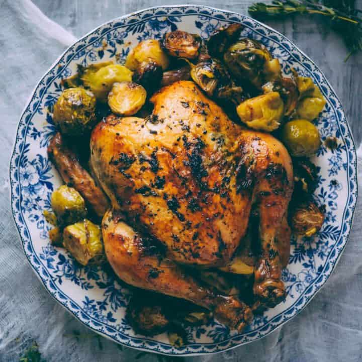 roast chicken served on a plate with a side of Brussels sprouts