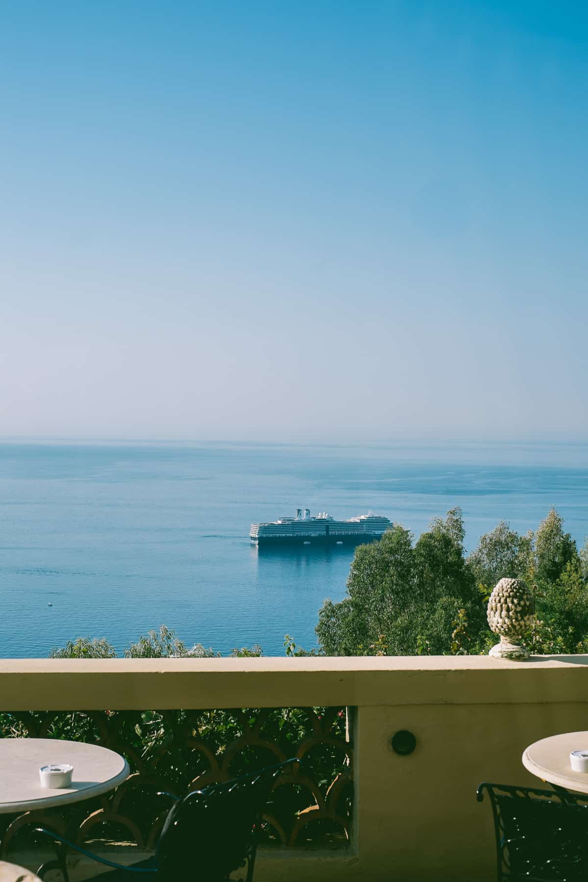 looking out into the sea from the balcony of old world hotel in Sicily
