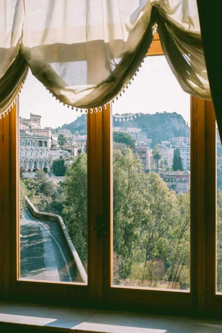 looking onto Taormina from the ornate windows of the San Domenico Palace Hotel Taormina Sicily