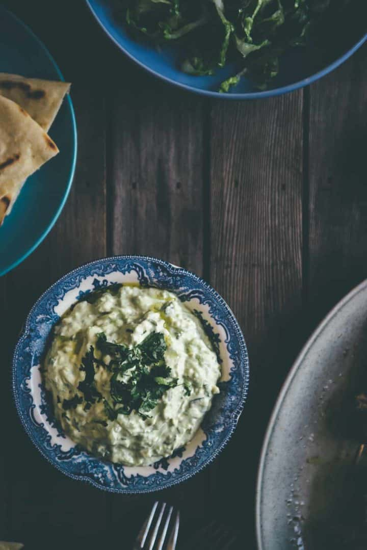 Greek yoghurt and garlic dip made with the addition of avocado in a bowl