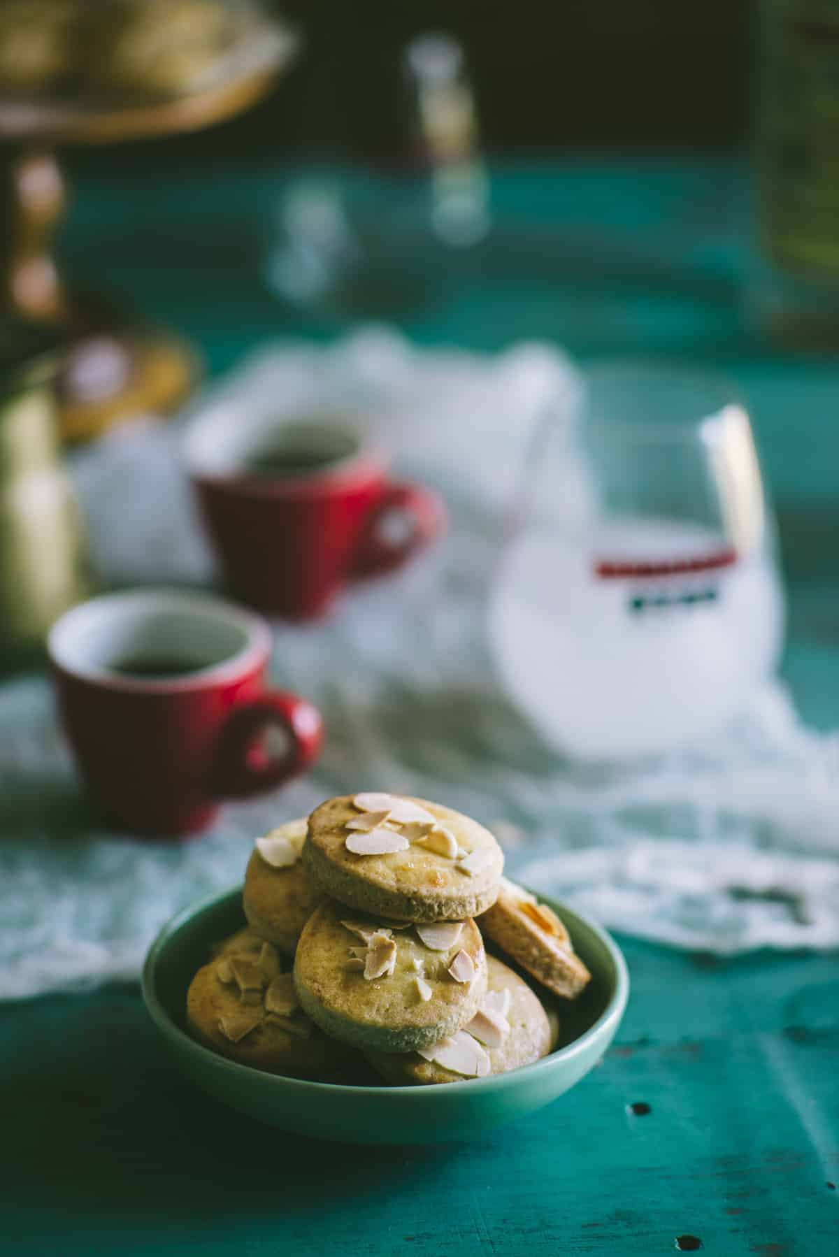biscuits made with ouzo and lemon and topped with flaked almonds